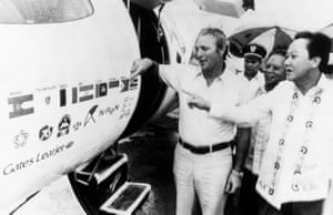 19 May 1976. Palmer shows Philippines tourism secretary Jose D. Aspiras the different insignias on his jet during a refuelling stop in Manila on a record-breaking around-the-would flight by executive jet.