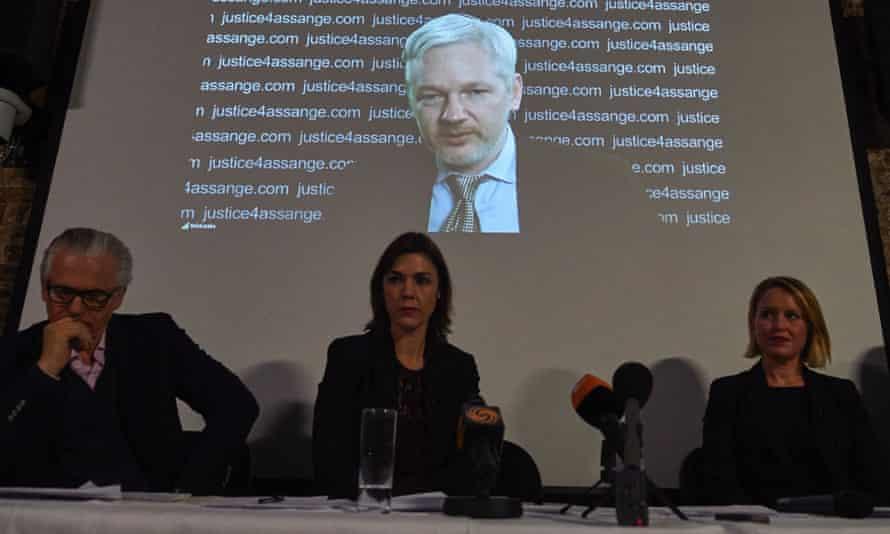 WikiLeaks founder Julian Assange is projected onto a screen behind Spanish jurist Baltasar Garzón and Australian lawyers Melinda Taylor and Jennifer Robinson.