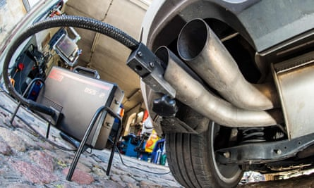 A measuring hose for emissions inspections in diesel engines sticking in the exhaust tube of a Volkswagen (VW) Golf 2,0 TDI diesel car
