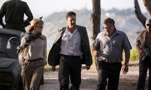 'Like any good spy tale, there's the wounded man in the center.' Rosamund Pike and Jon Hamm in Beirut.