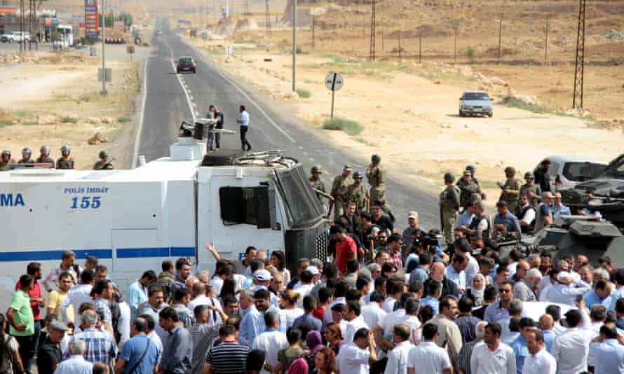 Turkish security forces block a road to stop a convoy carrying a delegation of the pro-Kurdish Peoples' Democratic party near the town of Midyat