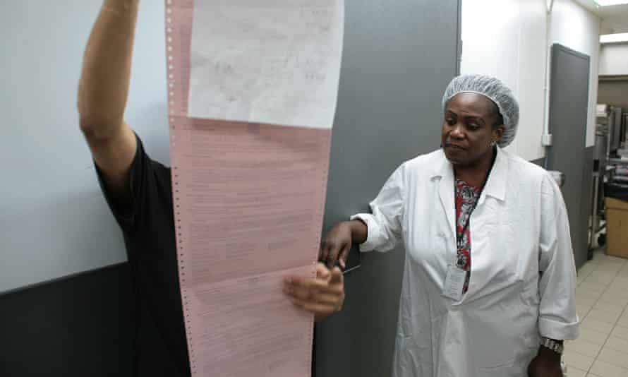 Sharon Nkansah looks at food safety paperwork at a branch of KFC
