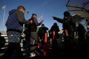 Commuters show their visas to border patrol agents to cross into El Paso from Ciudad Juarez.