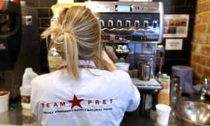 An employee prepares a cup of coffee inside a Pret A Manger sandwich store in London