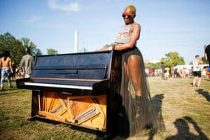 Woman next to piano