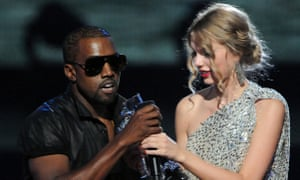 Wreck the mic... Kanye West jumps onstage as Taylor Swift accepts her 2009 VMA