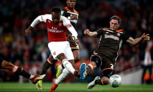 Arsenal's Alexandre Lacazette hammers in the decisive third in their Carabao Cup tie against Brentford.