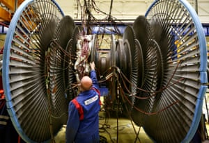 A worker at GE's Alstom power plant turbine in Rugby.