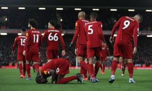 Sadio Mané kneels in prayer after scoring Liverpool's third goal.