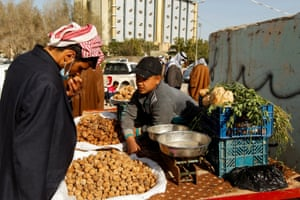 A man buys truffles at a market in the city of Samawa