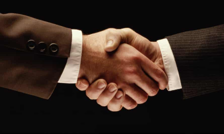 BUSINESSMEN shaking hands. In 2012-13, the government spent £58.2bn on subsidies, grants and corporate tax benefits. It took just £41.3bn in corporation tax receipts.