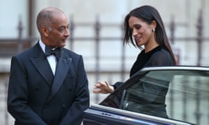 The Duchess of Sussex is met by the lord lieutenant of London, Sir Kenneth Olisa, at the Royal Academy.