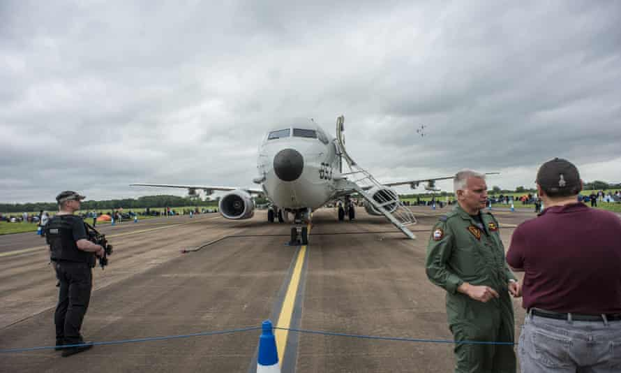 Police security in front of a US navy Boeing P-8A Poseidon at RAF Fairford