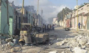 The wreckage of a vehicle lies among the rubble at the site of Saturday's attack in Mogadishu, Somalia.