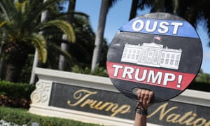 A protest outside the Trump Doral golf club in Miami. For many voters in Florida the impeachment trial still left a black cloud over his presidency.
