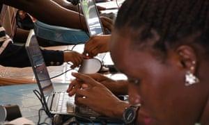 Refugees undergo biometric registration at Old Kampala secondary school