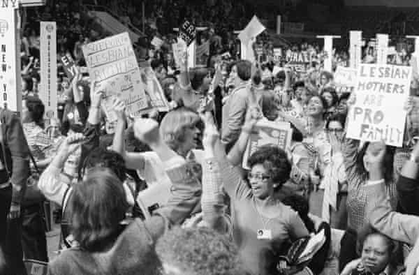 Delegates cheer the passing of a resolution supporting the equal rights amendment at the national women's conference in Houston, Texas in 1977