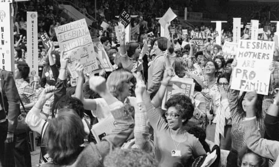 Delegates celebrate the passing of a resolution supporting the Equal Rights Amendment at the national women's conference in Houston, Texas in 1977