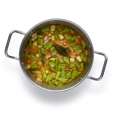 Add the beans and their cooking water, bring to a boil, then simmer for five minutes.
