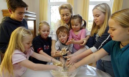 Ursula von der Leyen baking cookies with her seven children in 2003.