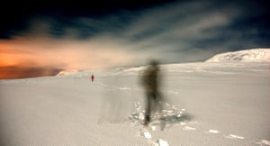 Alone in the white wilderness A two figures on their paths in the eerie white wilderness Photograph: Simon Bleasdale/GuardianWitness