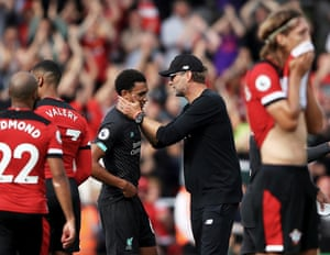 Jürgen Klopp embraces Trent Alexander-Arnold at the final whistle as Liverpool beat Southampton at St Mary's.