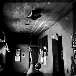 Angel trying to grab a balloon from the ceiling.