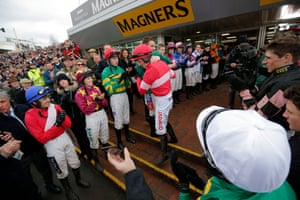 Before the Albert Bartlett Novices' Hurdle, Noel Fehily gets a hug from Darryl Jacob as fellow jockeys form a guard of honour as he comes out for his final ride at the Festival before retirement.
