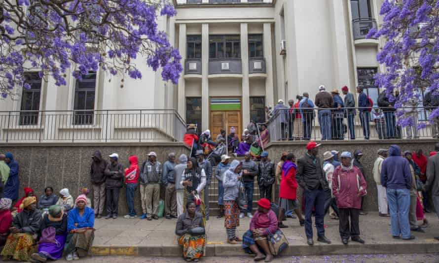 Pensioners queue to withdraw their pensions outside a branch of the Central African Building Society in Harare, Zimbabwe