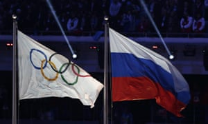 The Russian flag flies next to the Olympic flag during the closing ceremony of the 2014 Sochi Winter Olympics where it now seems Russian doping cover-ups were widespread.