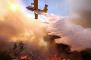 An air tanker drops water on a fire along the Ronald Reagan Freeway in Simi Valley, Calif., Monday, Nov. 12, 2018.