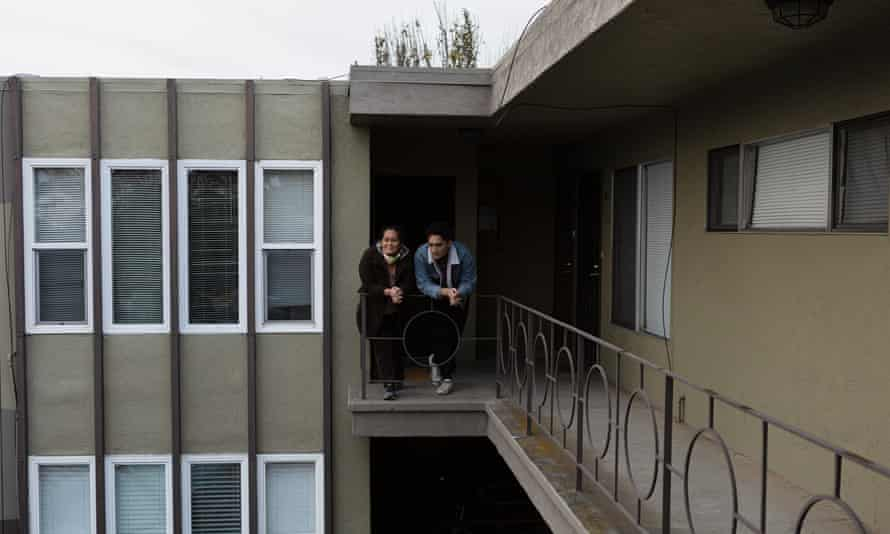 Loa Niumeitolu and her son outside their home in Berkeley, California