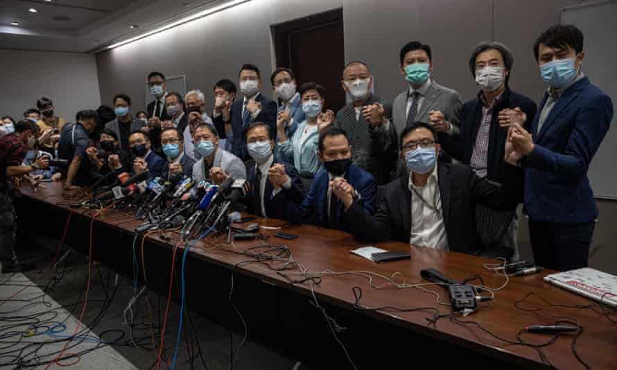 Pan-democratic lawmakers at a press conference in the legislative council. The 15 remaining opposition lawmakers resigned after four pro-democracy lawmakers were stripped of their seats.