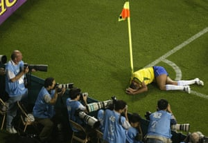 Rivaldo of Brazil clutches his face after being struck on the leg with the ball during Brazil's World Cup group match against Turkey in 2002.