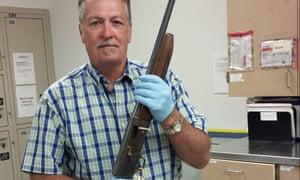 Detective Michael Ciesynski holds the shotgun Kurt Cobain used to kill himself in 1994.