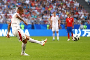 Serbia's Aleksandar Kolarov wallops a side-foot free-kick towards the near post.