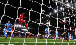 Divock Origi climbs highest to score Liverpool's second goal.