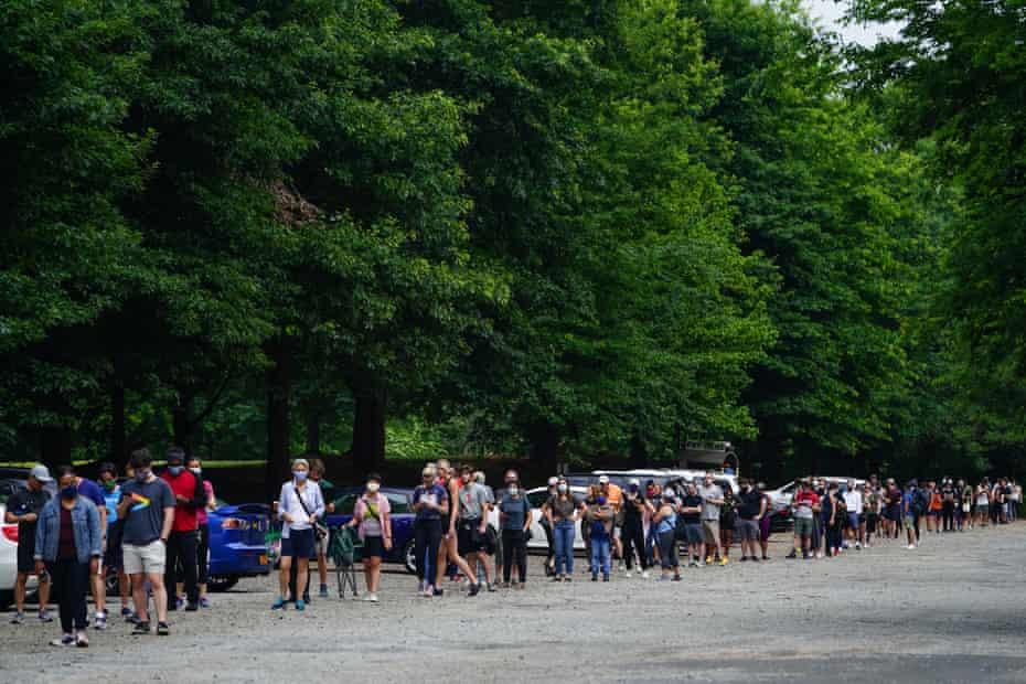 People wait in line to vote in Georgia's Primary Election on June 9, 2020 in Atlanta, Georgia. Georgia, West Virginia, South Carolina, North Dakota, and Nevada are holding primaries amid the coronavirus pandemic.