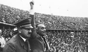 Adolf Hitler watching the Olympic Flame depart from the Lustgarten en route to the Olympic Stadium before the start of the 1936 Olympic Games in Berlin.