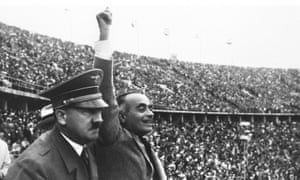 Hitler watches the Olympic Flame before the start of the 1936 Olympic Games. Photograph: IOC Olympic Museum /Allsport
