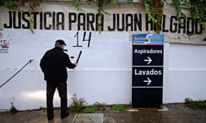 Francisco Holgado in 2010, marking the number of years since his son's murder on a protest banner outside the petrol station where he was killed.