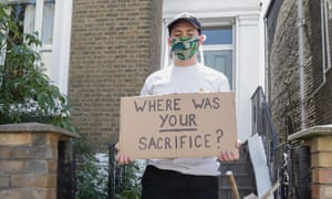 A demonstrator outside of Dominic Cummings' home.