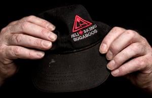 Norman Thomas's hands holding a ski cap