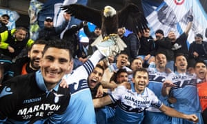 Lazio players celebrate the Rome derby victory with fans and the club's eagle mascot Olimpia.