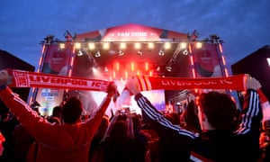 Liverpool fans watch live music at a designated 'fan zone' in Qatar.