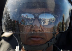 Qalqilya, West Bank: an Israeli border policeman looks on during an anti-Israel protest by Palestinians