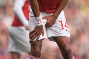 May 5: Pierre-Emerick Aubameyang of Arsenal holds his crotch after a collision against Brighton.