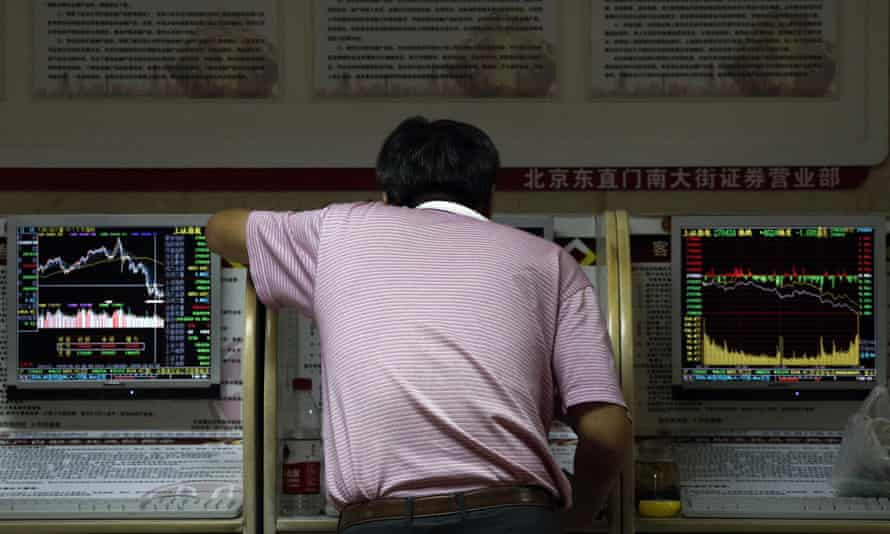 A man checks stock prices in Beijing