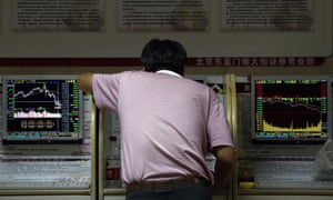 An investor checks stock prices at a brokerage house in Beijing.
