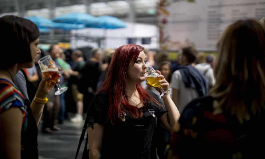 Ale enthusiasts sample drinks at the Great British Beer Festival in west London.